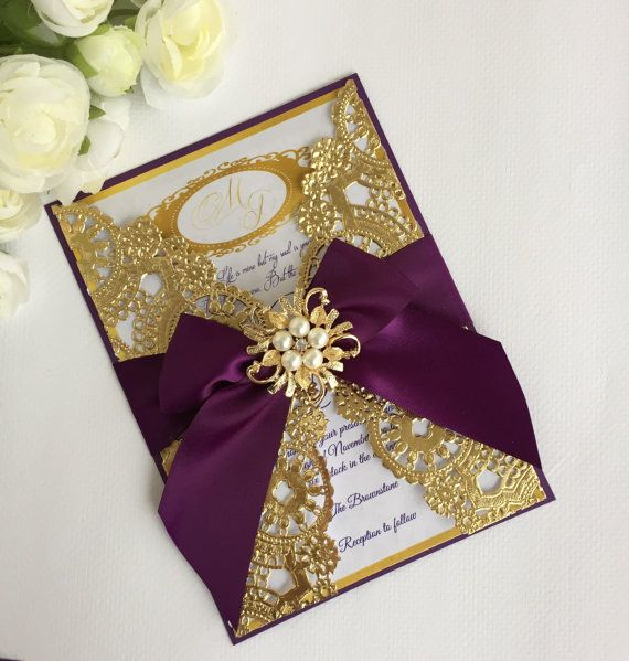 Double Layered invitation printed on a white pearlescent cardstock and backed on mettalic cardstock wrapped with a gold metallic doily and accented with a satin bow & topped with a pearl and rhinestone brooch, inside a gold box with a clear lid. Each invitation is $11.50 Invitation size