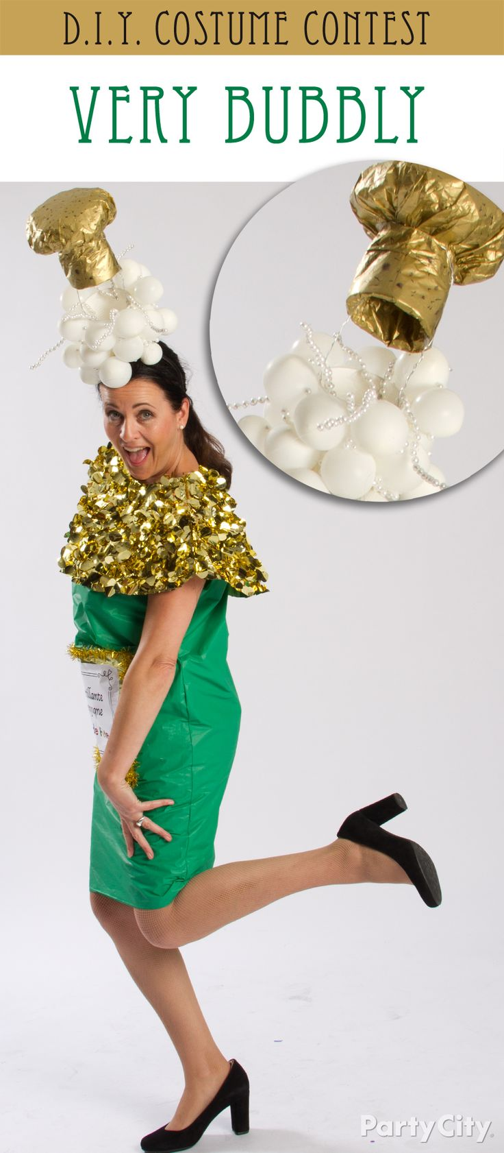 "Clare's champagne couture really *pops*! Her DIY champagne bottle costume is made from a green table cover and gold floral sheeting, and her fab fascinator is is a mix of small balloons, pearls on wire for ""bubbles"" and a ""cork"" made from gold tissue paper over bubble wrap. Mad glue gun skillz Clare!"