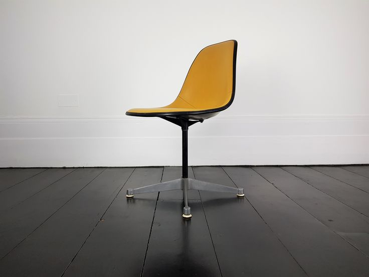 A Vintage Vinyl Upholstered Eames Swivel Chair   vinterior.co