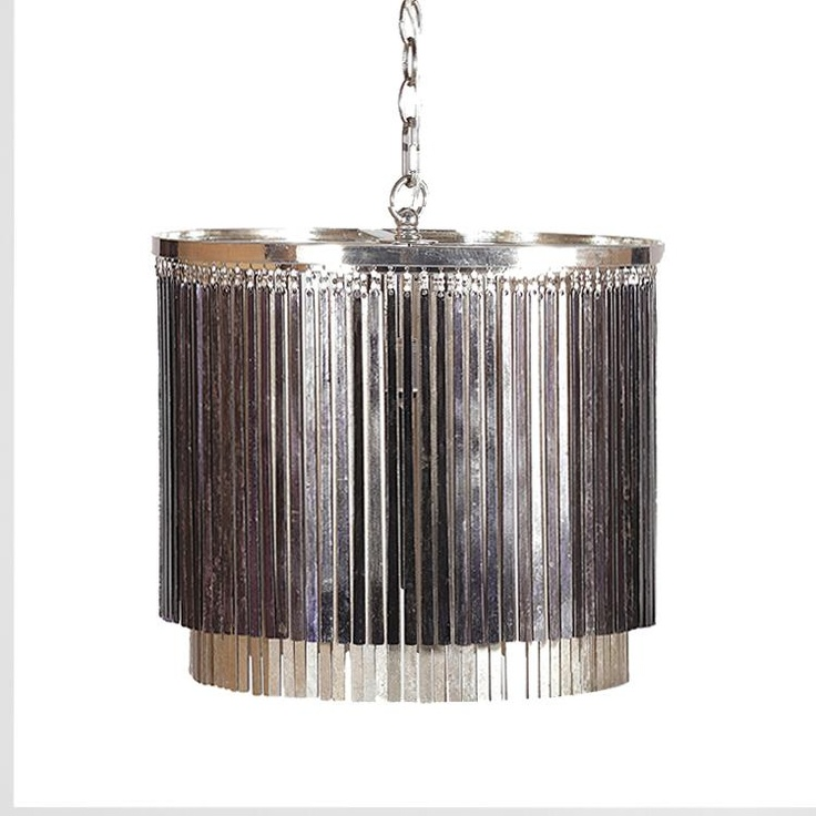 Shimmering silver and black rods hang from a modern chrome ring to create a unique shading on the Susan Chandelier. This versatile piece can serve as a pendant light or as a chandelier.    Materials:  Metal    Finish:  Silver, Black & Chrome