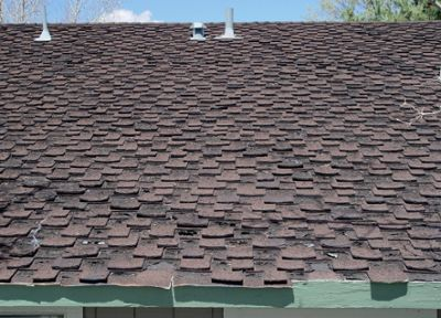 Comparison Time - Asphalt Shingles vs Metal Roofing