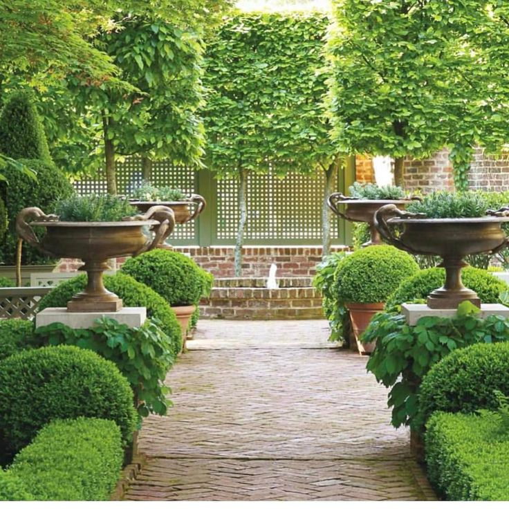 """2,178 Likes, 24 Comments - Melissa Penfold (@melissa_penfold) on Instagram: """"We love this downright dreamy courtyard that's all hedges, herringbone bricks, urns and symmetry.…"""""""