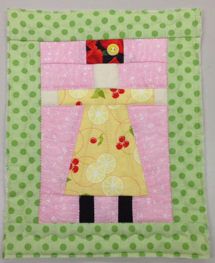 Small quilt. One lone small dolly. Made from The Burbs- Sarah Fielke.