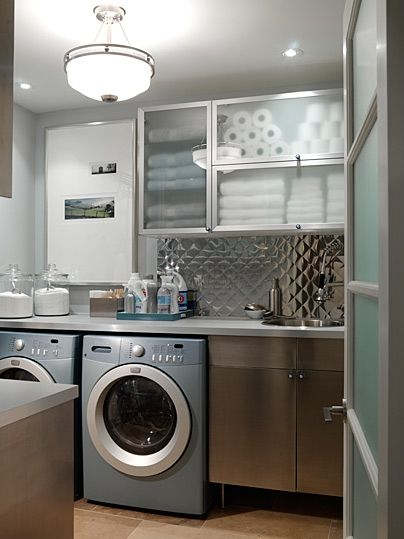 If you aren't feeling brave enough to use metal tile in your kitchen, why not try a smaller space like the laundry room?