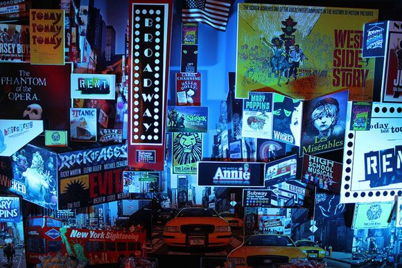 Make your guests feel like they're in Times Square with Broadway ads as a decorative backdrop.