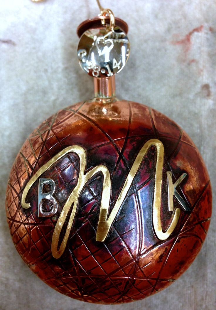 A custom ornament constructed of copper & brass