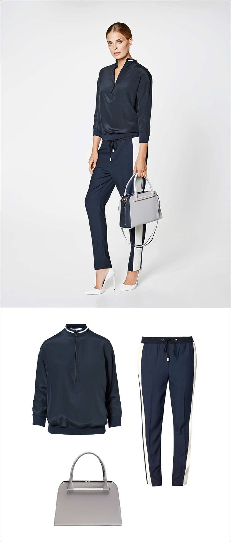 Women's Fashion Ideas - 12 Womens Outfits From Porsche Design's 2017 Spring/Summer Collection // This casual women's outfit features a navy blouse, a pair of navy and white pants, and a classic grey and navy purse.