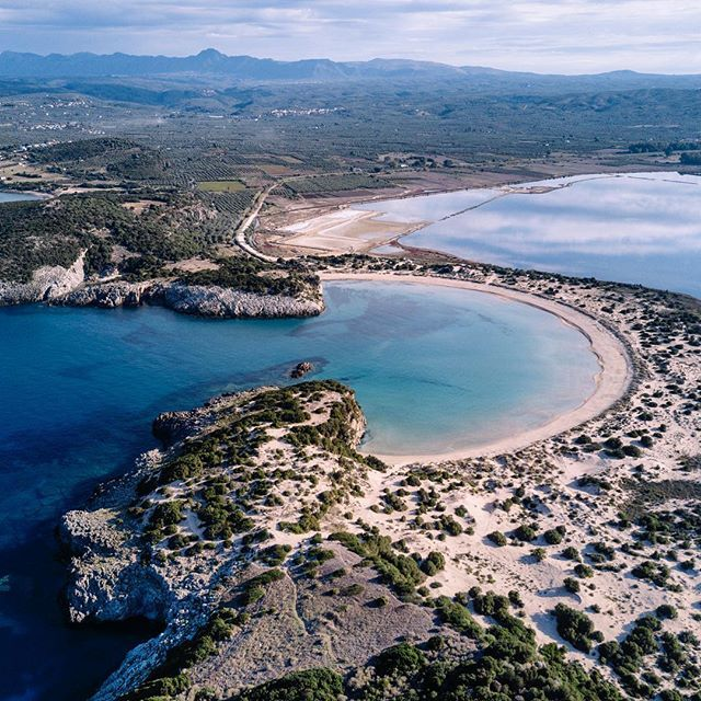 Taste the feeling of summer with this stunning view of the Voidokilia Beach in Crete. . Cant wait to release a video about this sun-kissed country!