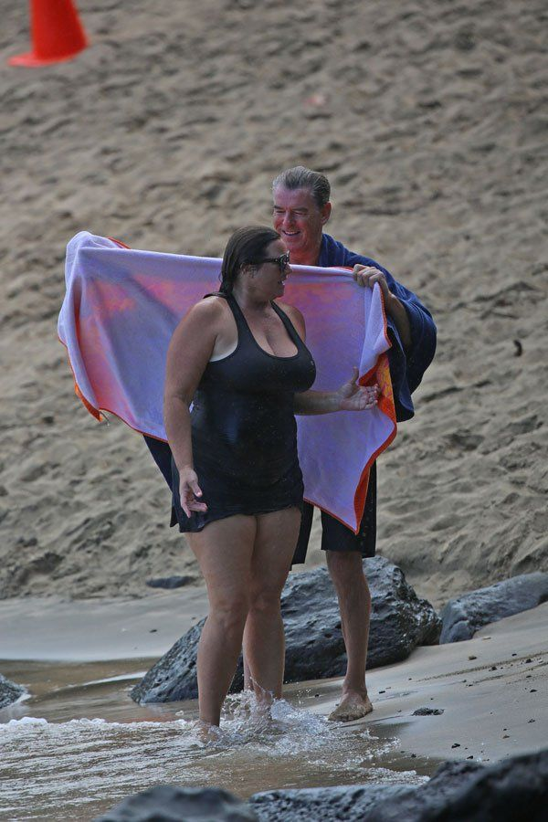 The awesome Pierce Brosnan wrapping his wife in a towel after a swim.  Love that she's not a super skinny woman!