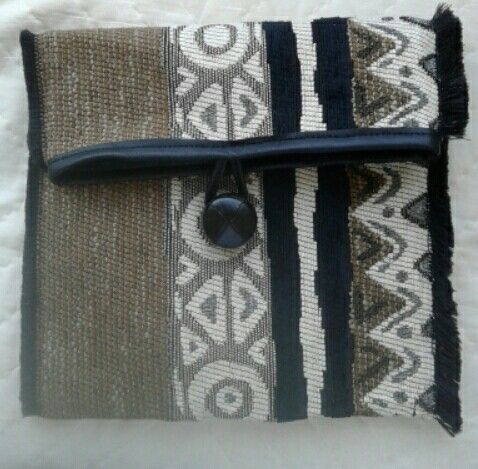 African clutch trimed with leather R80 phone 082 399 1985