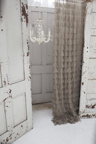 Curtains with ruffles/waterfall. they look fluffy and light! urban outfitters has some online apparently