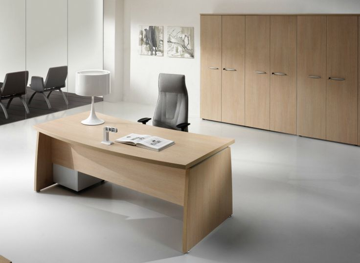 comp. OL003 #arredo #ufficio #direzionale composto da #scrivania a forte spessore con #top sagomato  e #mobile #archivio alto a sei ante.