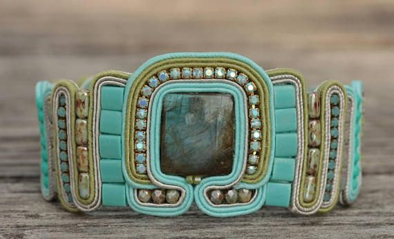Check out this item in my Etsy shop https://www.etsy.com/listing/557295356/labradorite-soutache-bold-bracelet-gift