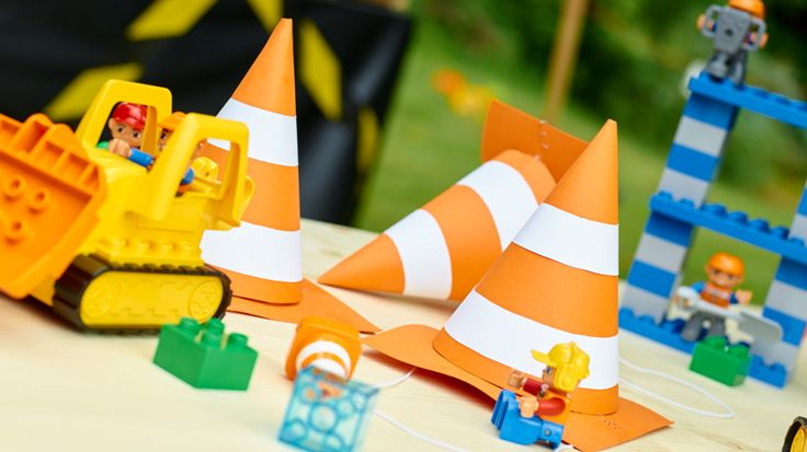 Caution!  These traffic cone party hats will make young guests at a construction-themed birthday party look more adorable than ever.