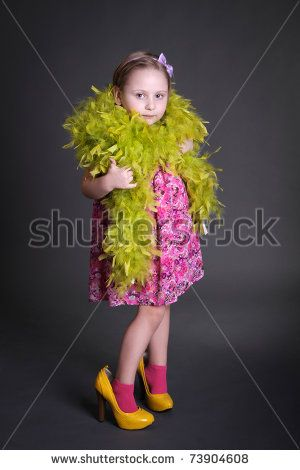 stock-photo-little-daughter-trying-mothers-big-shoes-and-boa-looking-at-camera-studio-shot-over-dark-grey-73904608.jpg (300×470)