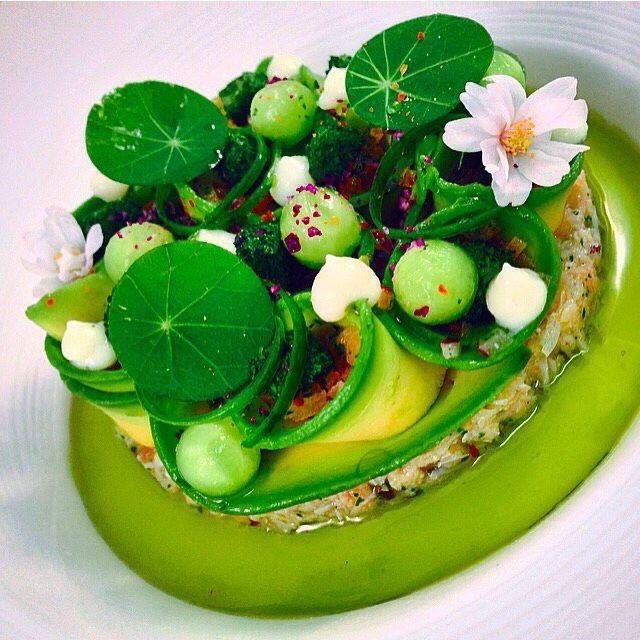 Gourmet food - crab salad, pea sauce, melon balls