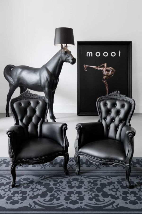 Moooi Smoke armchair  Furniture finished with fire. The beauty and character of burned wood is now captured in a long lasting material, creating the strange sensation of sitting on burnt furniture.  http://www.industryinterior.com/en/prod/living-room/armchair/moooi-smoke-armchair.html