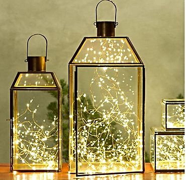 Fairy light idea! Stunning for wedding receptions and use them later for home decor this site also has lanterns available!  http://www.bliss-bridal-weddings.com/#!lighting/c1zlm