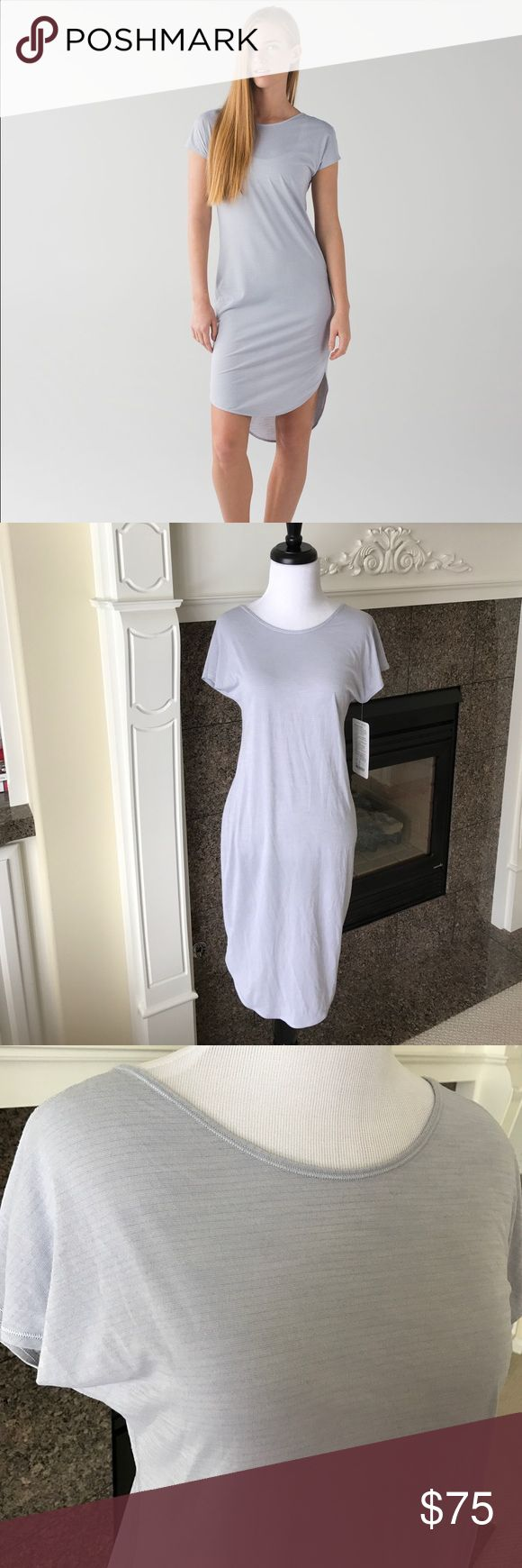 NWT Lululemon Retreat Dress HSFX Heathered Silver Cute and comfy Lululemon dress! NWT, Retreat dress in Heathered Silver Fox shade. No trades please! lululemon athletica Dresses High Low