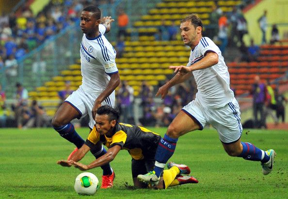 Branislav Ivanovic and Nathaniel Chalobah of Chelsea clashes with Nazrin of Malaysia during the match between Chelsea and Malaysia XI on July 21, 2013 at the Shah Alam Stadium in Shah Alam, Kuala Lumpur, Malaysia.