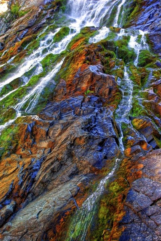 """Balea Waterfall - Fagaras, Romania.Balea Waterfall, also known as """"Urlatoarea Balei"""" is situated in Fagaras Mountains between peaks Moldoveanu and Negoiu at an altitude of 1234 m and Balea Lake at 2034 m, the largest waterfall in steps in Romania, with a fall of 60 m, and marks the bottom level of the glacial circle Balea."""