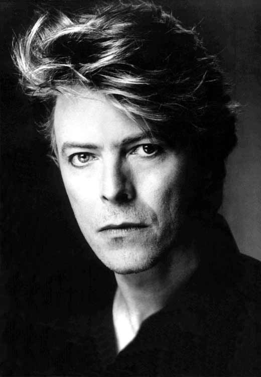 Black & White: Photo                                         WHO ELSE COULD HAVE ONE BLUE EYE AND ONE GREEN EYE BUT BOWIE!