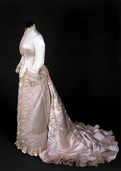 Wedding dress consisting of cream silk satin bodice and skirt and separate velvet train.l Victoria and Albert Museum #weddings