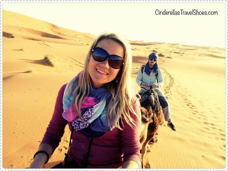 Riding Camels after sunrise in Sahara Desert