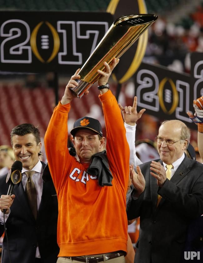 Head coach Dabo Swinney of the Clemson Tigers celebrates with the College Football Playoff National Championship Trophy after defeating the…