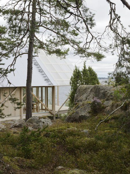 On Viggsö, an island of the Swedish Archipelago, architecture firm Arrhov Frick designed a two-story retreat, using simple but hardy materials. The roof, made from corrugated metal and fiber-reinforced plastic, joins the pine timber frame. Tagged: Exterior, House, and Wood Siding Material. Photo 2 of 7 in A Swedish Summer Cabin That Sits Above and Among the Trees