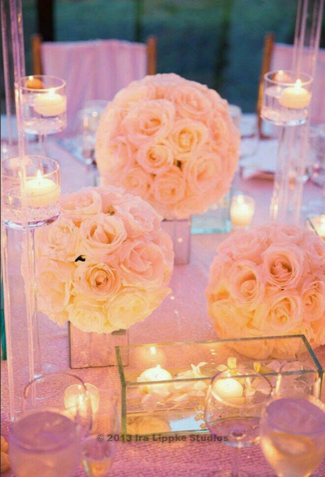 Pomander balls on mirror vases with candle light