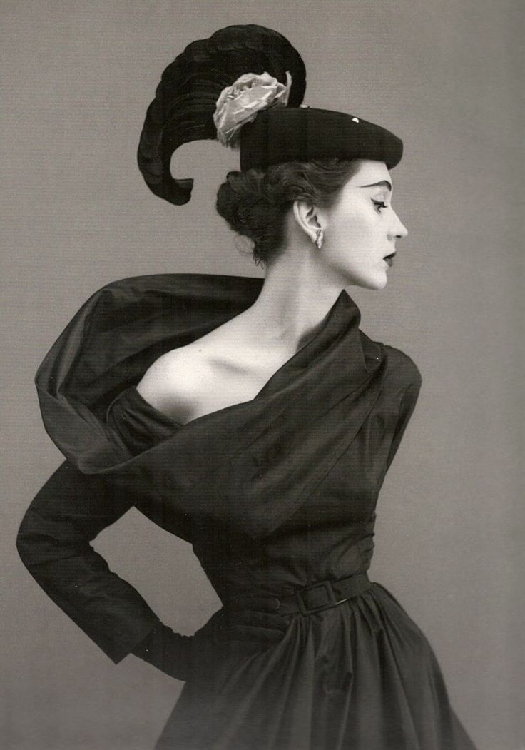 Dovima, wearing a hat and dress by Cristobal Balenciaga, in a 1950 photo by Richard Avedon for Vogue