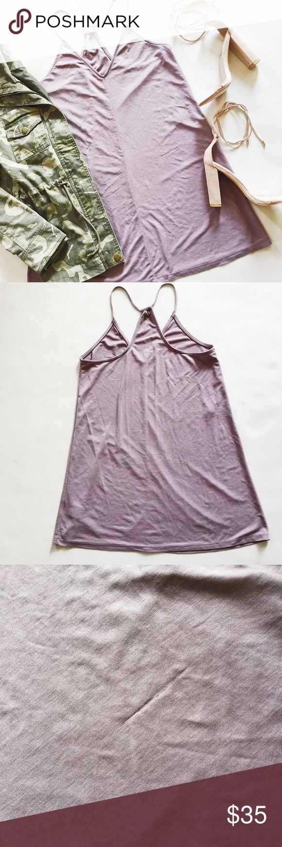 """- SALE - Silence and Noise Cupro Slip Dress Silence and Noise Cupro Slip Dress in lavendar.  Easy, pull on style.  Add a plain white tee underneath for a trendy spring look!  Hits mid-thigh, not quite as short as stock photo model.  Pre-loved but in great condition.  Small snag on front.  No other holes, stains or tears.  - SALE! $33 marked down to $26! -  Measurements laying flat: Armpit to armpit: 18"""" Waist (across): 20"""" Total length: 33"""" silence + noise Dresses"""