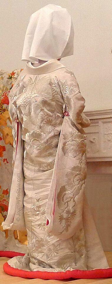 Japanese wedding: the bride's all-white 'shiromuku' uchikake and kimono ensemble from the back.
