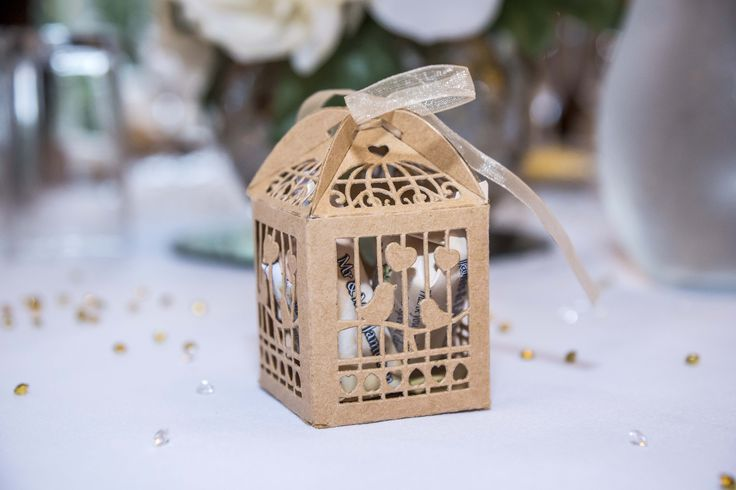 Brown bird cage box filled with personalised sweets.
