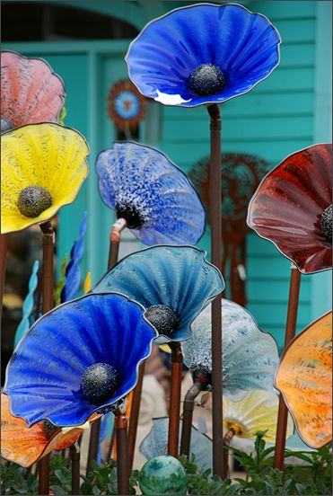 colorful glass flowers. no instructions, nothing about the flowers in the photo.