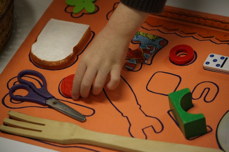 Use items from around your home to make a homemade shape puzzle!
