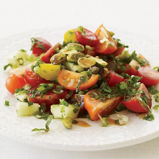 Turkish Tomato Salad with Fresh Herbs   Toasted pistachios add flavor and crunch to Turkish cooking authority Engin Akin's jalapeño-spiked tomato salad.