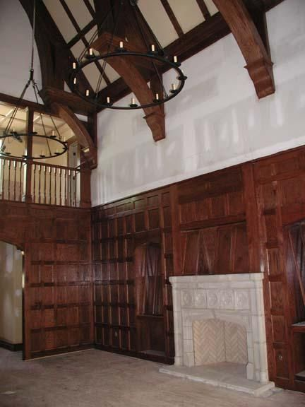 Library with paneling and tudor arch std fireplace with for Tudor style fireplace