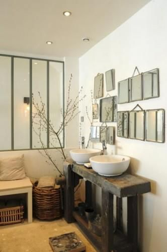 Love the multiple mirrors & individual basins combined with the natural wood
