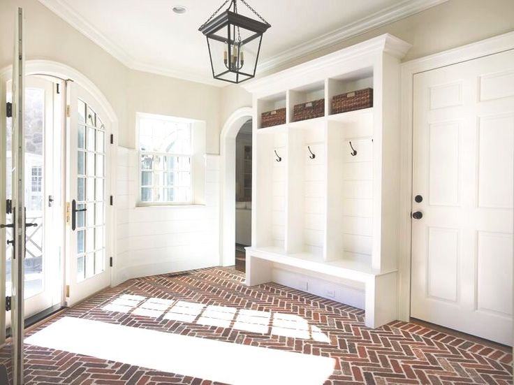 @aubreytate_ The herringbone brick floor in this mud room is EVERYTHING!