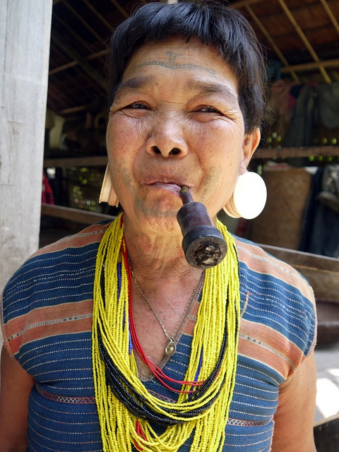 Attapeu, Laos. A Brao minority woman in her traditional costume. and face tattoos