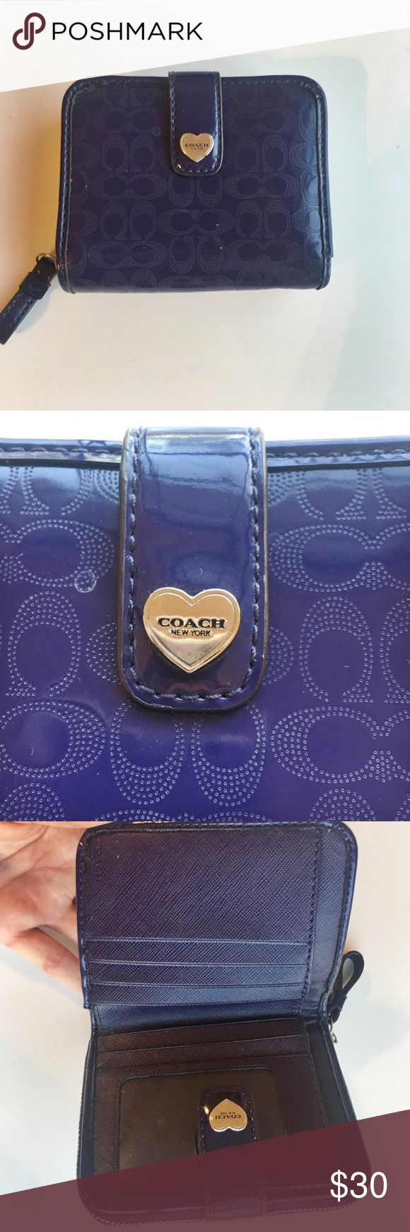 Purple patten leather embossed Coach wallet This a once used purple patten leather coach wallet. Great condition. There's no scratches, no scuffs, all the original hardware is intact/works. The wallet has an ID holder and can hold seven additional cards as well as cash. The zipper part holds six cards and coins. Coach Bags Wallets