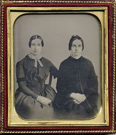 Emily Dickinson (left). Scholars at Amherst College in Mass. believe a collector found  just the second known photo of Emily Dickinson. The daguerreotype, c.1859, when she was around 30, shows her sitting next to a friend, Kate Scott Turner. The photo contradicts a misperception that she never left her house, when in fact she was quite social in her younger years. It also shows a strikingly different image from the only existing photo of Dickinson as a frail, teen girl. (repin)