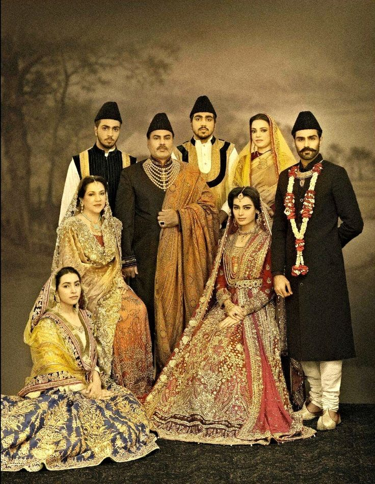 A Family Portrait of a Traditional Pakistani Wedding. Men wearing Sherwani's & Jinnah caps.