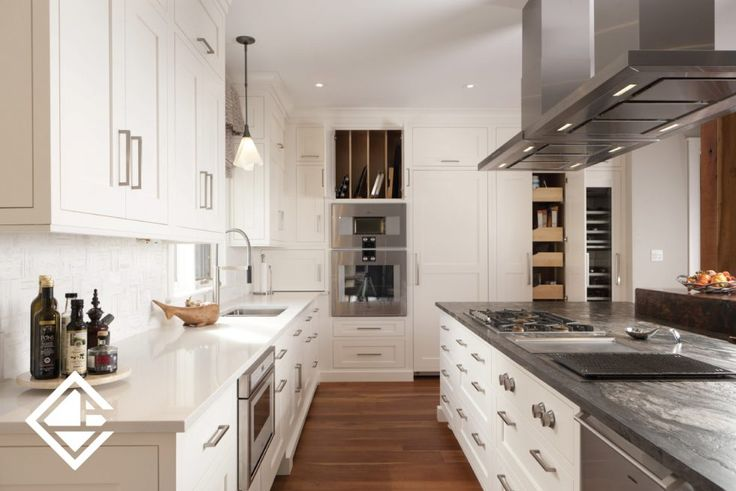 Dream white kitchen with a variety of materials used throughout, including relcaimed barnboard countertop, granite + quartz. Perfect for cottage or rustic home.