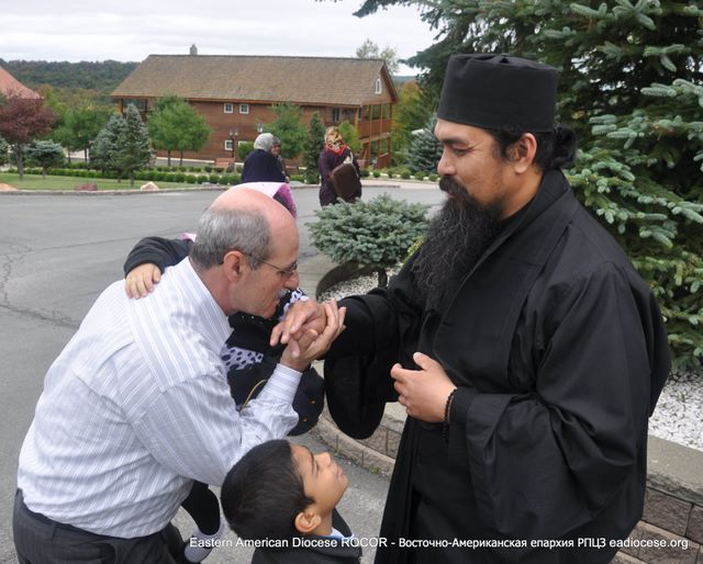 George Doulouklakis taking a blessing.