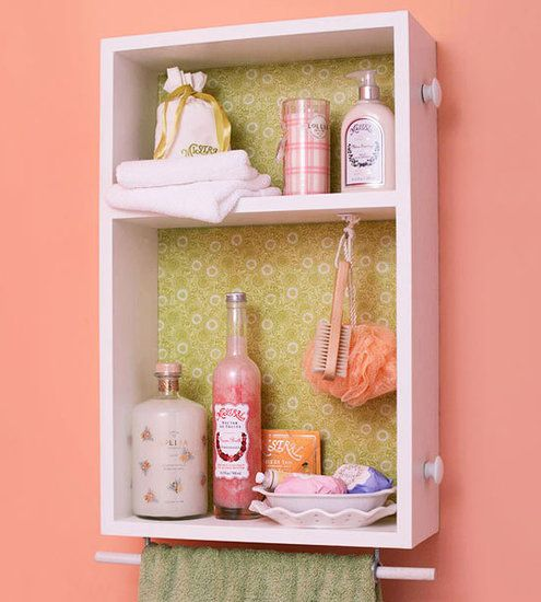 Drawer Cabinet:Turn a drawer into a medicine cabinet by adding a plank of wood to serve as a divider and papering the back with pretty wallpaper.   Source: Better Homes and Gardens