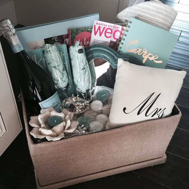 "Engagement gift basket for my brothers new fiancé  The knot wedding planner binder, the knot book of lists, bridal magazines, champagne, champagne glasses, ring holder, heart mirror, tote for bridal expos, candles, and ""Mrs."" Decorative Pillow"