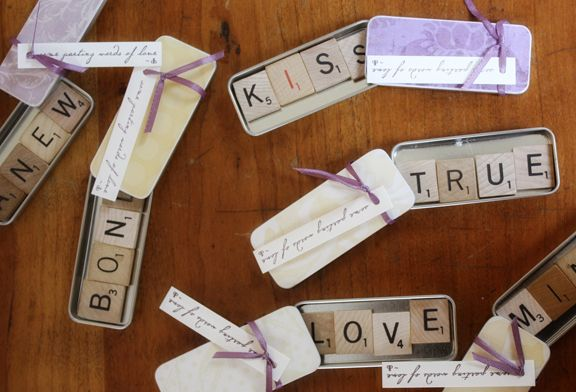 cheap wedding favors - scrabble tile magnets.....This would go along with the save the dates :)